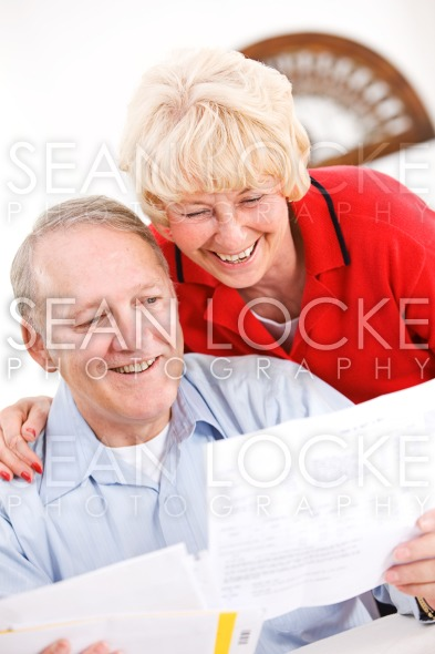 Seniors: Happy To Pay Off Bills Stock Photography Content by Sean Locke