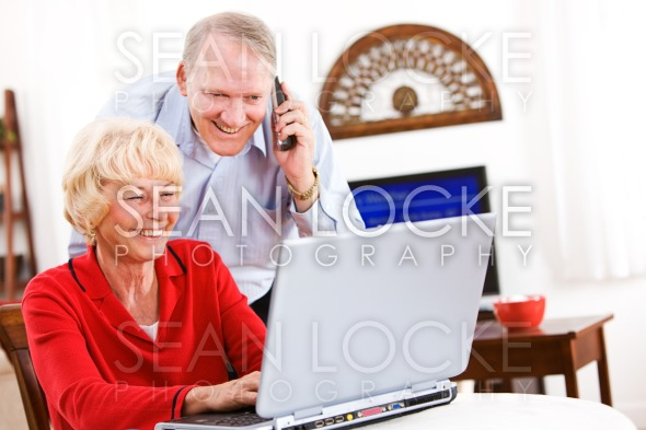 Seniors: Senior Couple Gets Telephone Support For Computer Stock Photography Content by Sean Locke