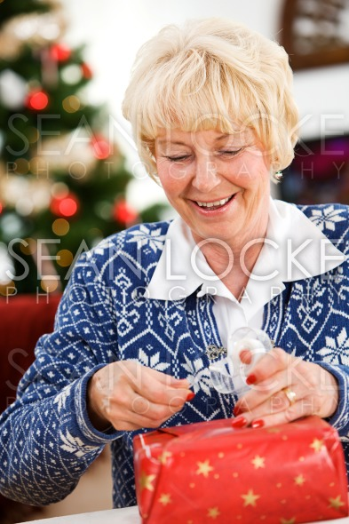 Christmas: Pulling Off Tape To Seal Gift Stock Photography Content by Sean Locke