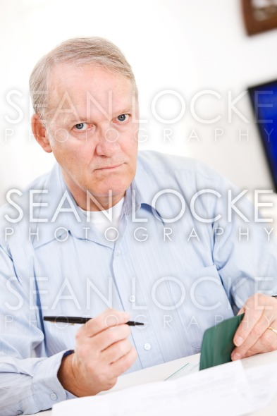 Seniors: Senior Man Tired Of Paying Bills Stock Photography Content by Sean Locke