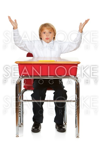 Student: Frustrated Boy At Desk Stock Photography Content by Sean Locke