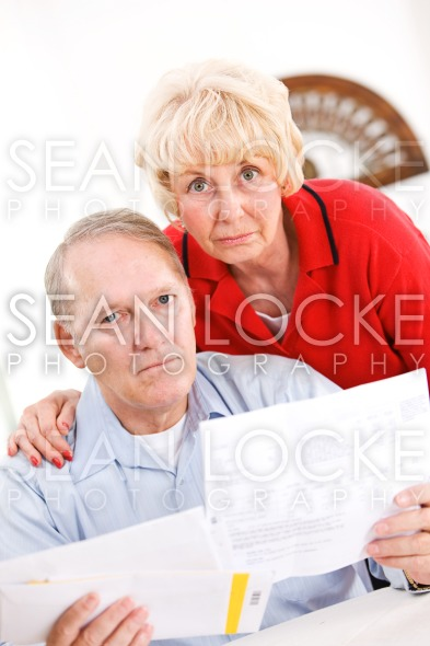 Seniors: Couple Not Happy About Bills Stock Photography Content by Sean Locke