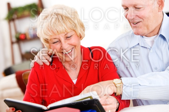 Seniors: Couple Looking At Old Scrapbooks Stock Photography Content by Sean Locke