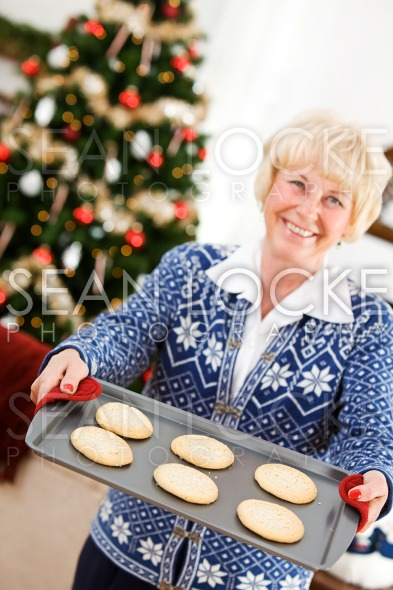 Christmas: Woman Holding Tray Of Christmas Cookies Stock Photography Content by Sean Locke