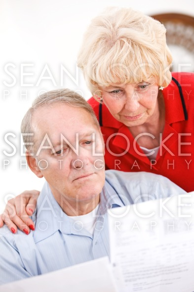 Seniors: Couple Upset At Amount Of Bills Stock Photography Content by Sean Locke