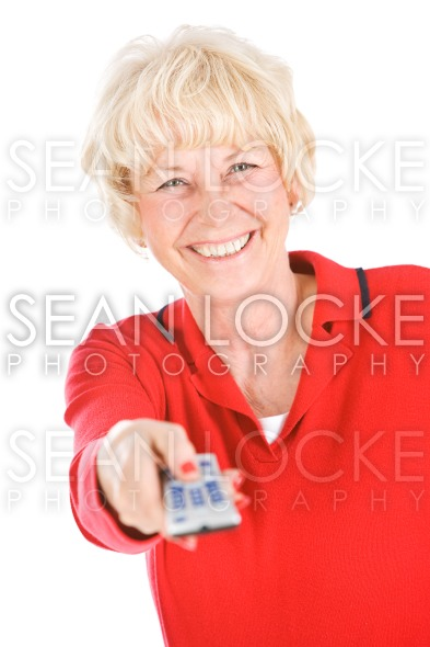 Seniors: Holding Up A TV Remote Stock Photography Content by Sean Locke
