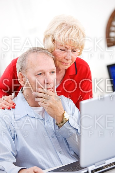 Seniors: Couple Confused By Computer Problems Stock Photography Content by Sean Locke