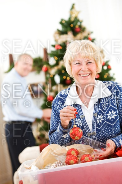 Christmas: Senior Couple Ready To Decorate Tree Stock Photography Content by Sean Locke