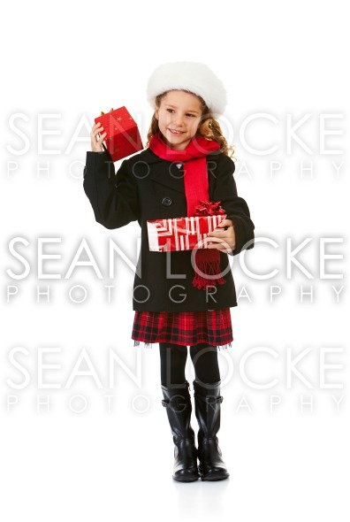Winter: Cute Winter Girl With Christmas Present Stock Photography Content by Sean Locke