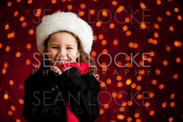 Christmas: Cute Holiday Girl With Big Smile Stock Photography Content by Sean Locke
