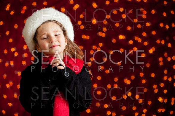 Christmas: Winter Girl With Holiday Wish Stock Photography Content by Sean Locke