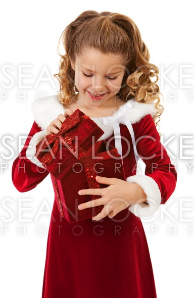 Christmas: Little Girl Opens Christmas Box Stock Photography Content by Sean Locke