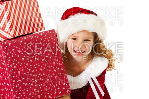 Christmas: Little Girl Peeks From Behind Gifts Stock Photography Content by Sean Locke