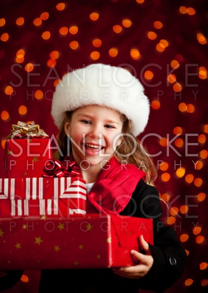 Christmas: Cute Girl With Holiday Gifts Stock Photography Content by Sean Locke