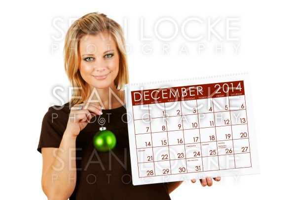 2014 Calendar: Holding December Christmas Ornament Stock Photography Content by Sean Locke