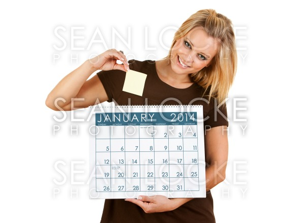 2014 Calendar: Putting A Sticky Note On A Date Stock Photography Content by Sean Locke
