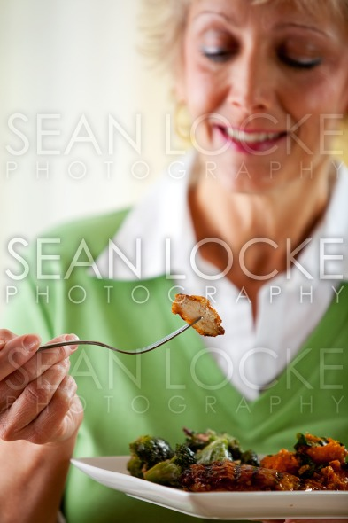 Couple: Taking a Bite of Grilled Chicken Stock Photography Content by Sean Locke