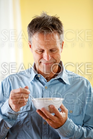 Couple: Ready to Have Cereal for Breakfast Stock Photography Content by Sean Locke