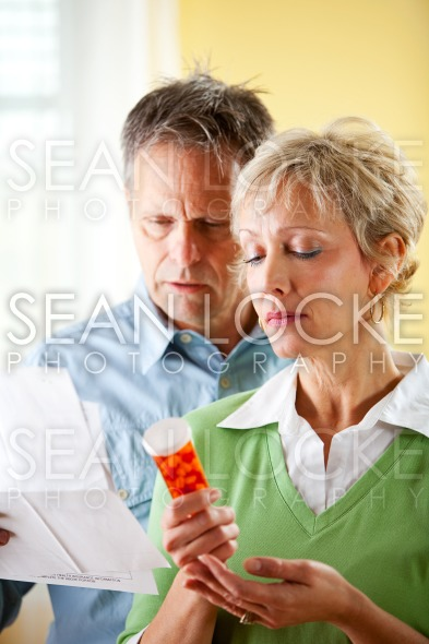 Couple: Man and Woman Concerned About Prescription Stock Photography Content by Sean Locke