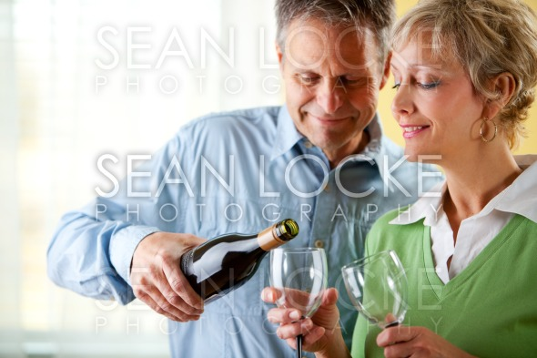 Couple: Having a Glass of Red Wine Stock Photography Content by Sean Locke