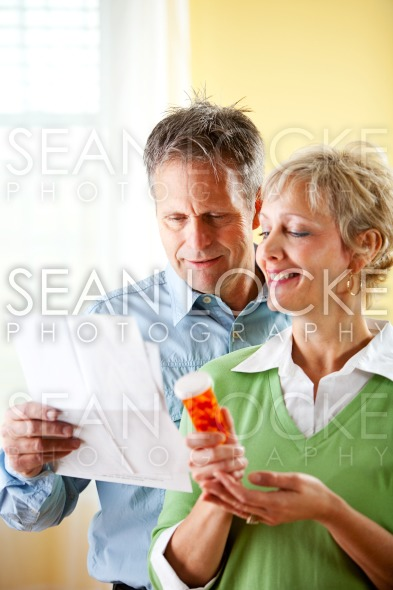 Couple: Man and Woman Dealing with Medication Stock Photography Content by Sean Locke