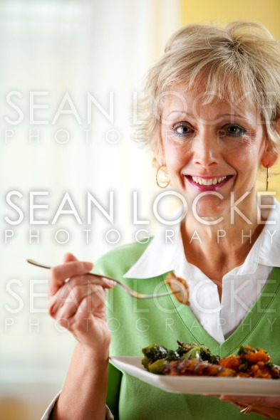 Couple: A Healthy Dinner of Grilled Chicken Stock Photography Content by Sean Locke