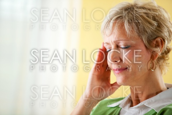 Couple: Woman Has a Headache Stock Photography Content by Sean Locke