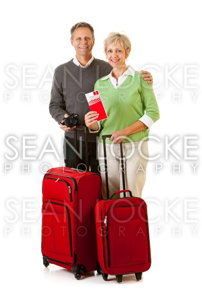 Couple: Passengers Standing with Luggage Stock Photography Content by Sean Locke