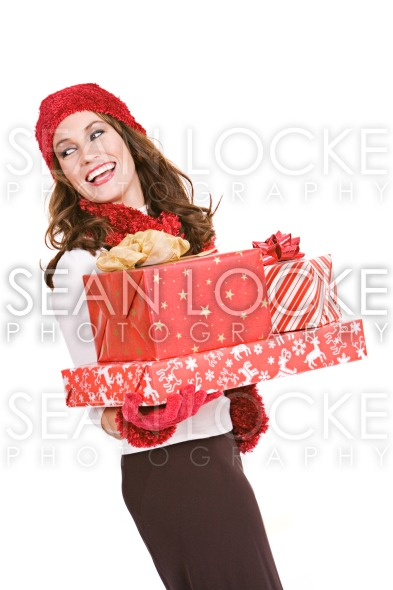 Christmas: Woman Holding Stack of Wrapped Gifts Stock Photography Content by Sean Locke