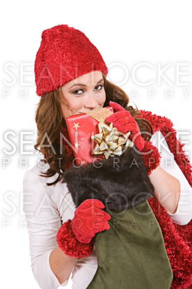 Christmas: Peeking Over Christmas Stocking Stock Photography Content by Sean Locke