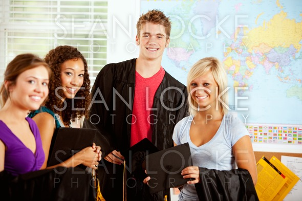 Students: Teens In Class With Graduation Caps and Gowns Stock Photography Content by Sean Locke