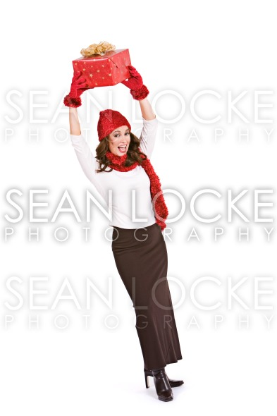 Christmas: Holding a Wrapped Gift In The Air Stock Photography Content by Sean Locke