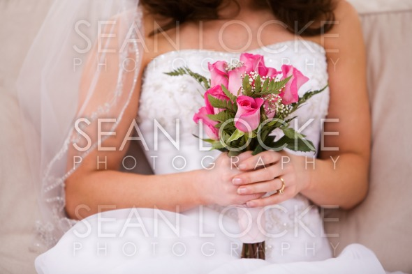 Bride: Anonymous Woman On Couch With Bouquet Stock Photography Content by Sean Locke