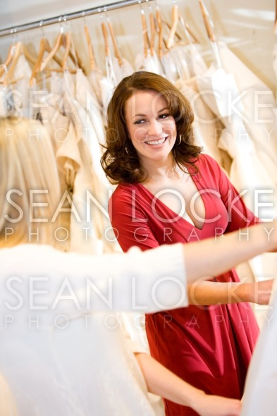 Bride: Bride and Friend Looking at Wedding Gowns Stock Photography Content by Sean Locke
