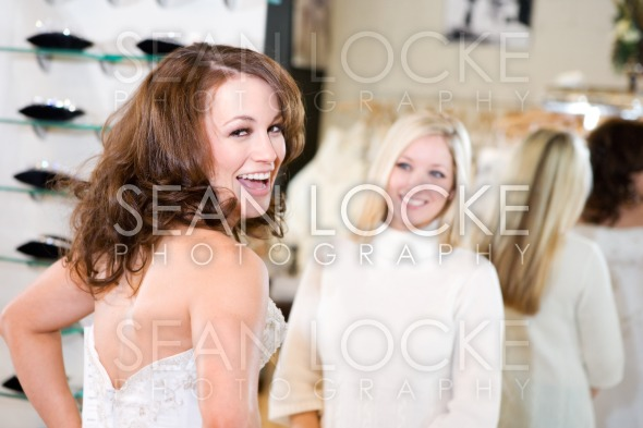 Bride: Woman Excited Over Wedding Gown Stock Photography Content by Sean Locke