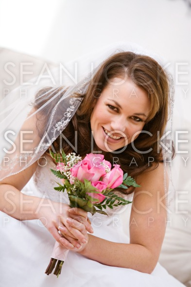 Bride: Sitting On Couch With Bouquet Stock Photography Content by Sean Locke
