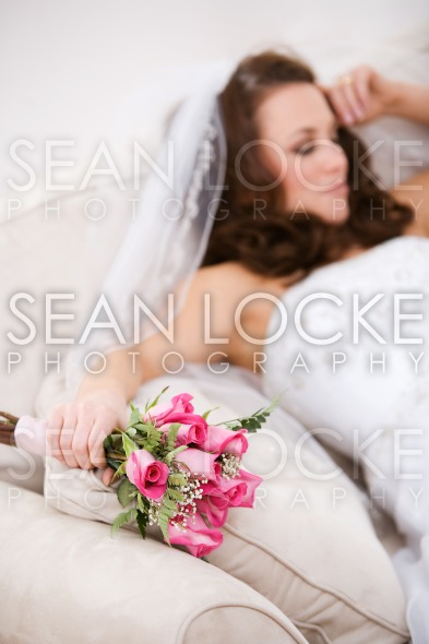 Bride: Tired Bride Rests On Couch With Bouquet Stock Photography Content by Sean Locke