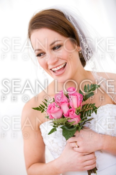 Bride: Pretty Woman Holding Rose Bouquet Stock Photography Content by Sean Locke