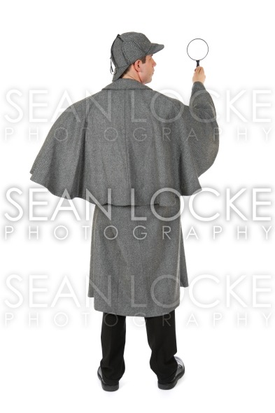Sherlock: Rear View Of Man Holding Up Magnifying Glass Stock Photography Content by Sean Locke