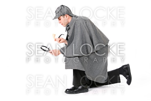 Sherlock: Detective Using Magnifying Glass To Examine Something Stock Photography Content by Sean Locke