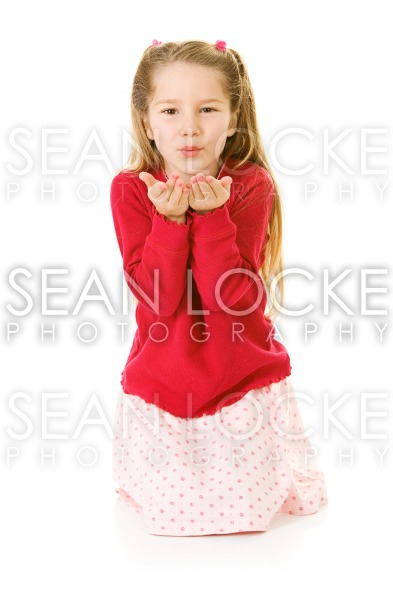 Girl: Young Child Blows A Kiss To Camera Stock Photography Content by Sean Locke