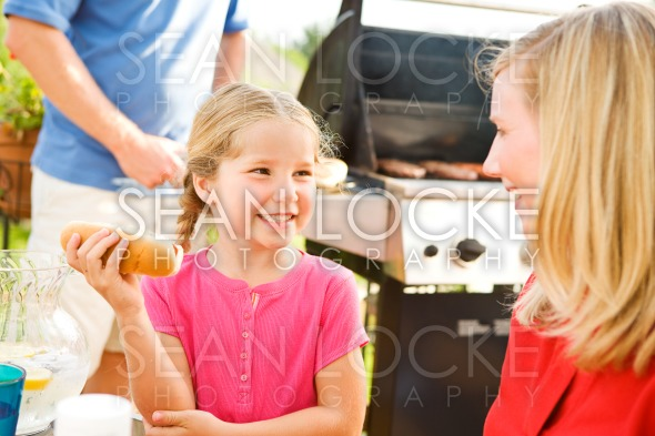 Summer: Girl Talking with Mother Before Eating Stock Photography Content by Sean Locke