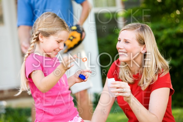 Summer: Blowing Bubbles with Mom Stock Photography Content by Sean Locke