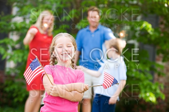 Summer: Cute Girl with American Flags Stock Photography Content by Sean Locke