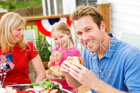 Summer: Dad Eating a Hamburger Stock Photography Content by Sean Locke