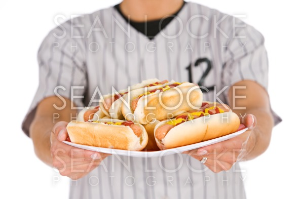 Baseball: Player Holding Plate of Hot Dogs Stock Photography Content by Sean Locke