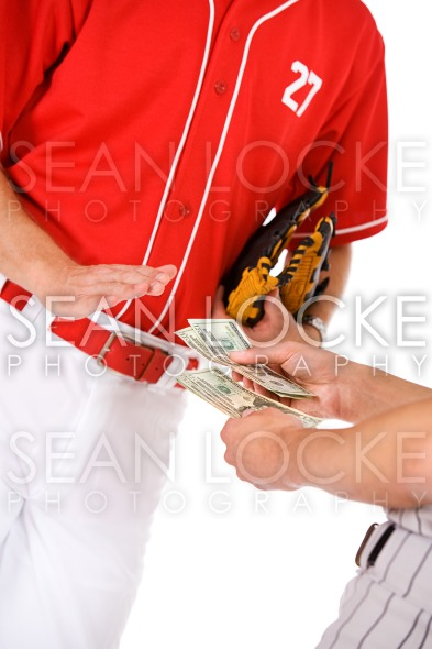 Baseball: Players Exchanging Money In Bet Or Bribe Stock Photography Content by Sean Locke