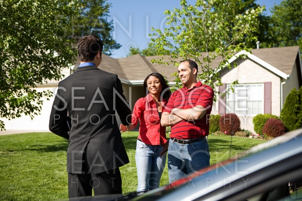 Home: Couple Meets with Real Estate Agent Stock Photography Content by Sean Locke