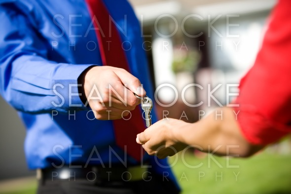 Home: Agent Hands Over New House Keys Stock Photography Content by Sean Locke