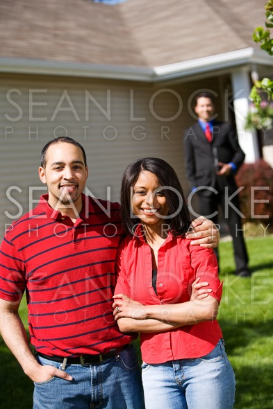 Home: Couple Ready to Work with Real Estate Agent Stock Photography Content by Sean Locke